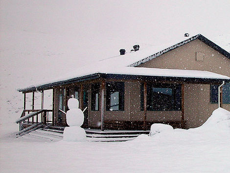 Woolshed Creek Hut and snowman - Mt Somers