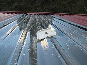 Improvised repair to hole in roof of Big Tops Hut in the Koropuku.