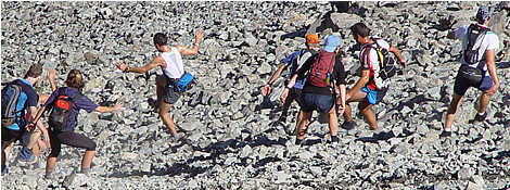 Group of runners race down the Crow Slide in the 2006 Avalanche Peak Challenge